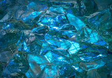 Turquoise background of shiny-crystal stones lit mysterious glow Stock Images