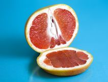 Ripe grapefruit on turquoise background royalty free stock images