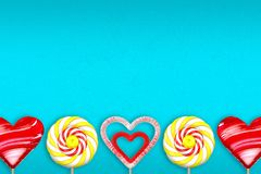 Turquoise background with various lollipops. 3d illustration. Turquoise gradient background with various lollipops. Lollipop in the shape of heart. Lollipop Stock Images