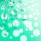 Turquoise background with white blurred bokeh and long curly branches with leaves and flowers Stock Photo