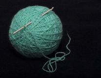 Turquoise ball of acrylic-wool yarn and crochet hook Royalty Free Stock Photo