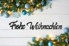 Turquoise Balls, Frohe Weihnachten Means Merry Christmas, Fairy Lights. Christmas Banner With German Calligraphy Frohe Weihnachten Means Merry Christmas. Fir royalty free stock image