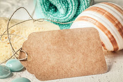 Turquoise bath towel and blank tag Stock Photography