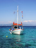 Turquoise Bay with a sailboat Royalty Free Stock Photo