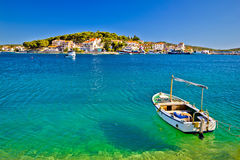 Turquoise beach and boat in Rogoznica Stock Images