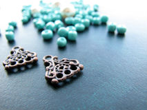 Turquoise beads and pieces of earrings, handmade jewelry Stock Photos