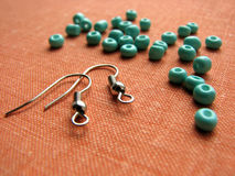 Turquoise beads and pieces for making earrings, handmade jewelry Stock Photography