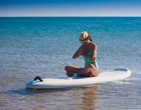 Turquoise bikini sea, surfing board, yoga royalty free stock image