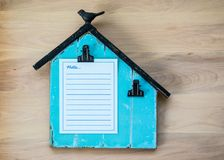 Memo board shaped like a barn with blank paper for customized message Stock Photography