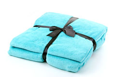Turquoise Blanket. On bright background Royalty Free Stock Photography