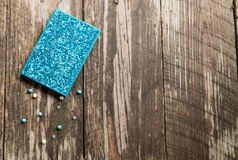 Turquoise bling journal with scattered beads Royalty Free Stock Photos