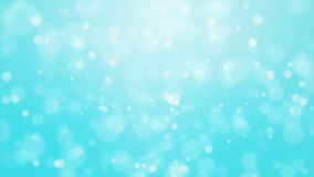 Turquoise blue background with light bokeh particles. Festive turquoise blue bokeh background with flickering light particles imitating underwater bubbles stock video footage