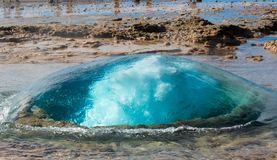 The turquoise blue boiling bubble of Strokkur Geyser before eruption. Gold Circle. Iceland royalty free stock photography