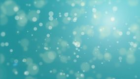 Turquoise blue bokeh particle background. Turquoise blue bokeh background with floating light particles stock video