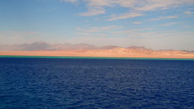 Turquoise and blue color of the Red Sea. On the horizon, the deserted shore of the Sinai peninsula stock video