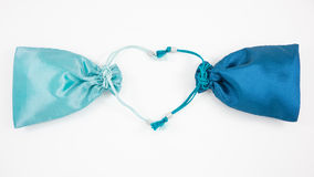 The turquoise blue and deep blue silk mini gift pouch bags Stock Photos