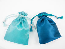 The turquoise blue and deep blue silk mini gift pouch bags Royalty Free Stock Image