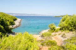 Turquoise, blue and green. Secret nudist beach, Hvar island Croatia Stock Photography