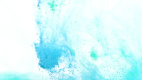 Turquoise and blue ink in water stock footage
