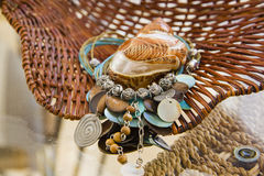 Turquoise blue necklace and shells over straw basket Stock Photography