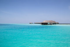 Turquoise blue ocean and water villas in the Maldives Royalty Free Stock Image