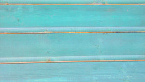 Turquoise blue painted wooden planks background Stock Images