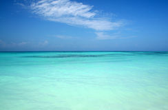 Turquoise Blue Sea. The warm light blue waters off of the coast of Zanzibar Stock Photography