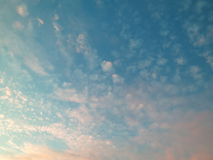 Turquoise Blue Sky with white and pink clouds Stock Images