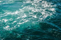Turquoise blue surface of the sea. With foam. Deepness of the sea Royalty Free Stock Photos