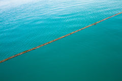 Turquoise Blue Water divided into stagnant sea and ripple Stock Photography