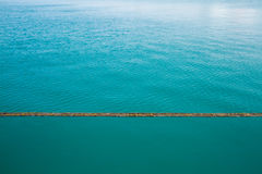 Turquoise Blue Water divided into stagnant sea and ripple Royalty Free Stock Images