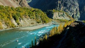 Turquoise blue water of Ghizer river flowing through forest in Gahkuch, Gilgit Baltistan, Pakistan. stock footage