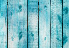 Turquoise blue wooden planks on direct sunlight. Flat view royalty free stock photography