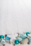Turquoise and blue wooden snowy white christmas background with Royalty Free Stock Photos