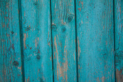 Turquoise board with peeling paint Stock Photos