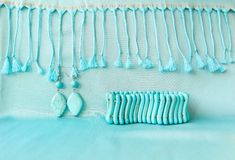 Turquoise bracelet and earrings from natural stone on fringed scarf royalty free stock photos