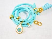 Turquoise bracelet with evil eye Stock Image