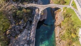 Turquoise Bridge Lavertezzo River Rocks Ticino Switzerland Aerial 4k