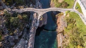 Turquoise Bridge Valley Verzasca River Rocks Ticino Switzerland Aerial 4k