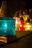 Turquoise candle in the cemetery while All Saints' Day.  stock photography