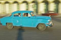 A turquoise car driving the streets of Old Havana, Cuba Stock Photo