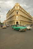 Turquoise car driving the streets of Old Havana, Cuba Royalty Free Stock Photography
