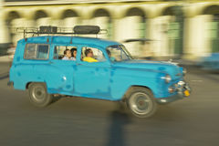A turquoise car driving the streets of Old Havana, Cuba Royalty Free Stock Photography