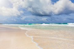 Turquoise Caribbean ocean with cloudscape and sun in Tulum Royalty Free Stock Image