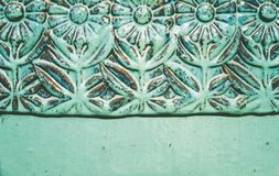 Turquoise ceramic floral relief royalty free stock images