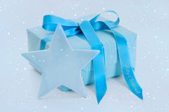 Turquoise christmas present with ribbon and star. Royalty Free Stock Photography