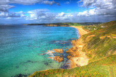 Turquoise clear sea Praa Sands Cornwall England in colourful HDR Stock Photo