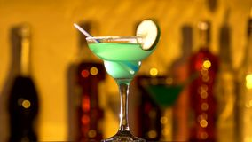 Turquoise cocktail with lime decortion and coconut. Turquoise delicious cocktail with lime decortion, tubules and coconut on edge, rotation stock video