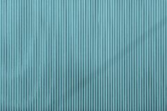 Turquoise color corrugated texture of a surface iron leaf. Turquoise color corrugated wavy texture of a surface of an iron leaf for empty and pure backgrounds stock photo