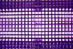 Turquoise color metal mesh with a square pattern on a bright lamp with gradient effect on a black background, close-up of movie il Royalty Free Stock Photos